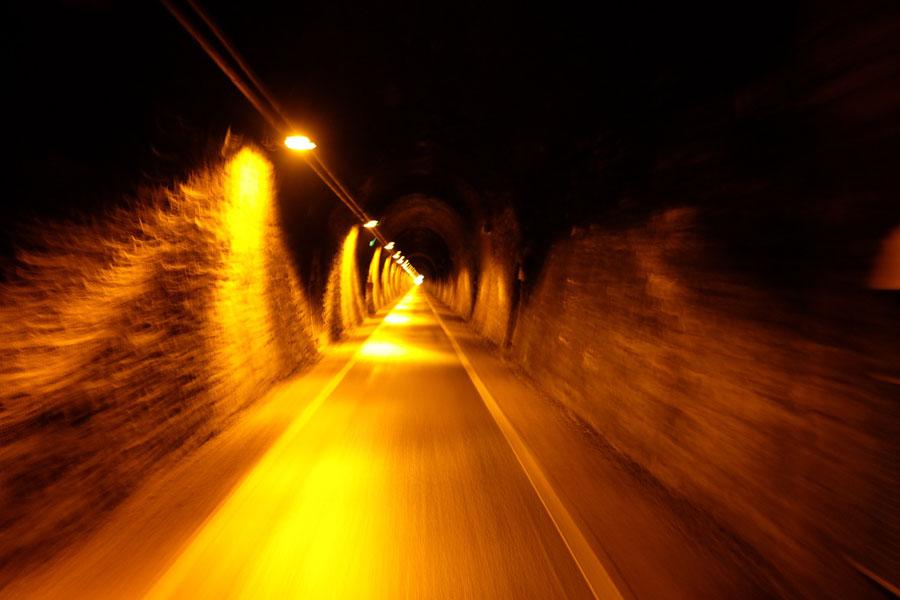 Cycling through the long Milseburgtunnel on BahnRadweg Hessen.