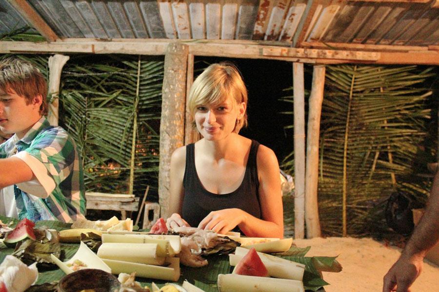 Enjoying a traditional Tongan feast.