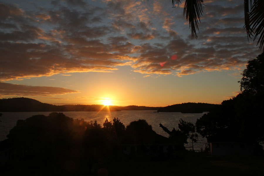 Sunset over a bay of Vava'u, Tonga.